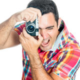 Man using a vintage looking compact camera Stock Image