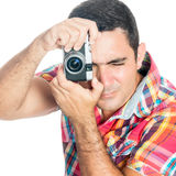Man using a vintage looking compact camera  on white Royalty Free Stock Image
