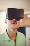 Man using virtual glasses. In restaurant Royalty Free Stock Photography