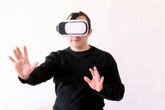 Man using a virtual glasses on white background. Young male business executive using virtual reality headset in office. Gays at office and using virtual Royalty Free Stock Images
