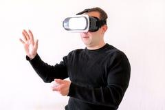 Man using a virtual glasses on white background Stock Photo