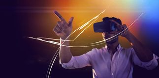 Man using a virtual reality device royalty free stock photography