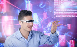 Man using virtual reality glasses against digitally generated background Royalty Free Stock Photo