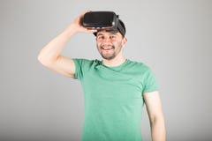Man using virtual reality glasses Stock Photo