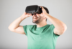 Man using virtual reality glasses Royalty Free Stock Images