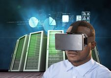 Man using virtual reality headset against data center background Royalty Free Stock Photo
