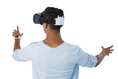 Man using virtual reality headset. Rear view of man using virtual reality headset against white background Stock Photography
