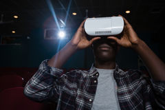 Man using virtual reality headset while watching movie Royalty Free Stock Images