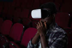 Man using virtual reality headset while watching movie. In theatre Stock Images