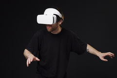 Man using virtual reality headset Stock Images