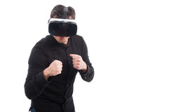 Man using VR glasses and giving a punch Stock Photos