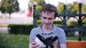 Man using vr glasses, remove them. Excited, impressed about new modern technology. stock video footage