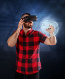 Man using VR glasses. Young man using VR glasses headset trying to touch objects in virtual reality Royalty Free Stock Photos