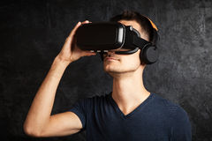 Man using VR goggles Stock Image