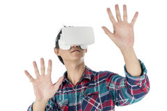 Man using a VR headset and experiencing virtual reality. Isolated on white background Stock Images