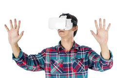 Man using a VR headset and experiencing virtual reality. Isolated on white background Stock Image