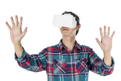 Man using a VR headset and experiencing virtual reality. Isolated on white background Stock Photography