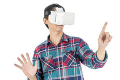 Man using a VR headset and experiencing virtual reality. Isolated on white background Stock Photo