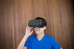 Man using VR headset glasses. Smile happy man getting experience using VR-headset glasses of virtual reality at home much gesticulating hands, asian male Royalty Free Stock Photography