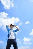 Man using VR headset glasses. Smile happy man getting experience using VR-headset glasses of virtual reality with sky and cloud background, asian male Stock Image