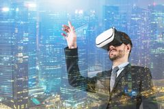 Man using VR headset in night city royalty free stock photography