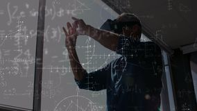 Man using a VR helmet with calculations on the foreground