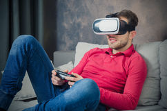 Man using VR virtual reality glasses and playing video games Royalty Free Stock Image
