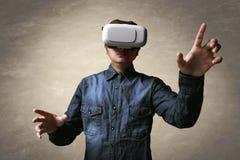 Man using vr. Man using virtual reality headset Royalty Free Stock Image