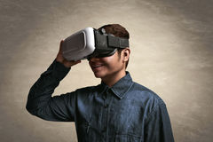 Man using vr. Man wearing virtual reality glasses Stock Photo
