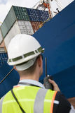 Man Using Walkie Talkie At Container Terminal Stock Images