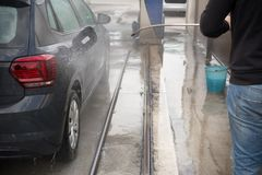 Man Using Water Pressure Machine to Wash a Car stock image