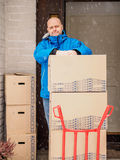 Man using the 2 wheel dolly Royalty Free Stock Photos