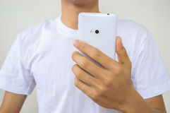 Man using white smart phone Stock Images