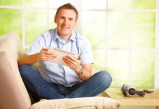 Man using white tablet Royalty Free Stock Images