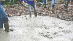 Man using a wooden spatula for cement after Pouring ready-mixed concrete. Man using a wooden spatula and vibrations machine  for cement after pouring ready-mixed stock video