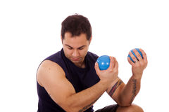Man using yoga ball weights Royalty Free Stock Image