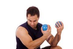 Man using yoga ball weights Royalty Free Stock Image