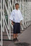 Man utanför Jil Sander modeshower som bygger för Milans Womens modeveckan 2014 Arkivbild