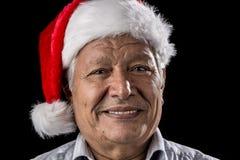 Man vénérable avec le père rouge Christmas Cap Images stock