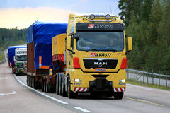 MAN V8 Wide Load Transport along Road Stock Photography