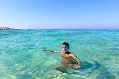 Man on vacation going swimming in the sea Royalty Free Stock Photography