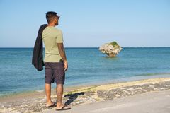 Man on vacation in Japan 3. Man on seawall on vacation in Japan with T shirt looking Stock Images