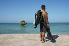 Man on vacation in Japan 10. Man on seawall on vacation in Japan with T shirt scuba diving Stock Photo