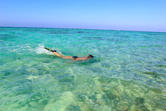 Man on vacation snorkeling in the sea Royalty Free Stock Photo