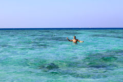 Man on vacation swimming in the sea Royalty Free Stock Photo