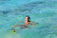 Man on vacation swimming in the sea Royalty Free Stock Photos