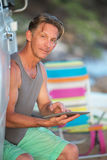 Man on Vacation with Tablet Computer Stock Photo