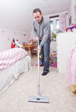 Man with a vacuum cleaner Royalty Free Stock Images