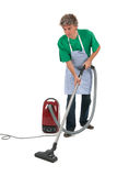Man with vacuum cleaner. Man working in house with vacuum cleaner Royalty Free Stock Image