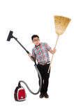 Man with vacuum cleaner and broom Royalty Free Stock Image